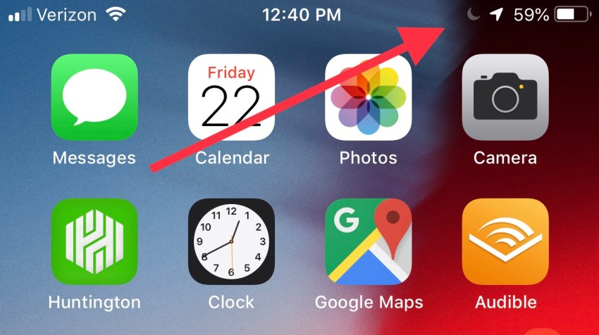 If you see a moon, you're iPhone is on Do Not Disturb mode.