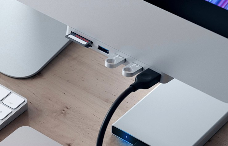 If you have a 2017 iMac or the iMac Pro, pick up this USB C hub that also connects to the edge of your iMac.