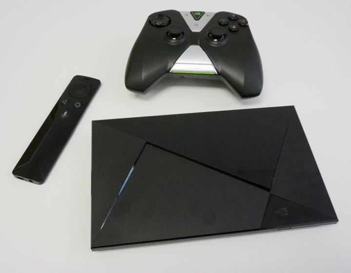 nvidia shield tv with remote and game controller