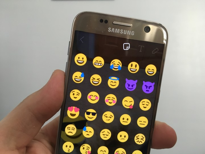Tap on the sticker icon then choose a sticker for 3D emoji in Snapchat.