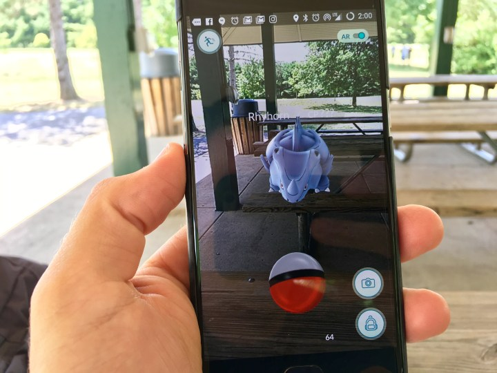 This is Pokémon Go. It is a game that uses your phone's location and mixes real and virtual worlds to catch Pokémon.