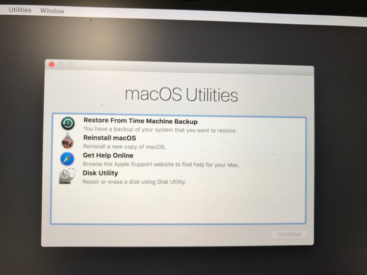 Boot into recovery to downgrade to OS X El Capitan by restoring a Time Machine backup.