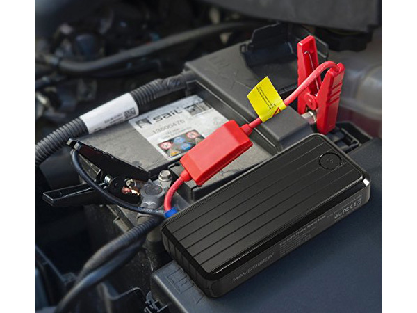 ravpower-portable-car-jump-starter-on-car-battery