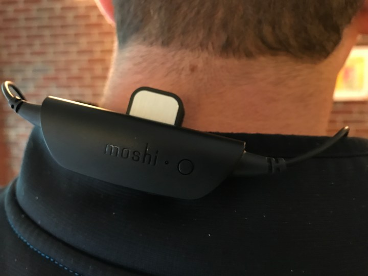 Clip the battery to your shirt using the included magnetic clip.