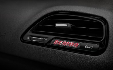 Gloss Black bezels are featured throughout the 2018 Dodge Challenger SRT Demon's interior. Passenger side IP bezel features carbon fiber badge, laser-etched with production sequence number.