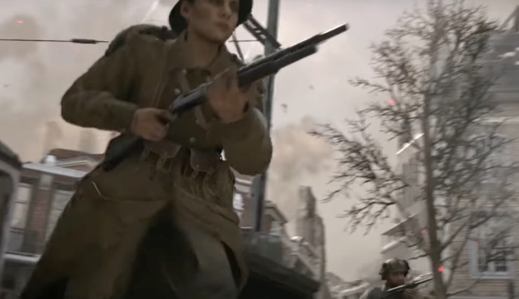 You can hear and see a woman player in the multiplayer trailer.