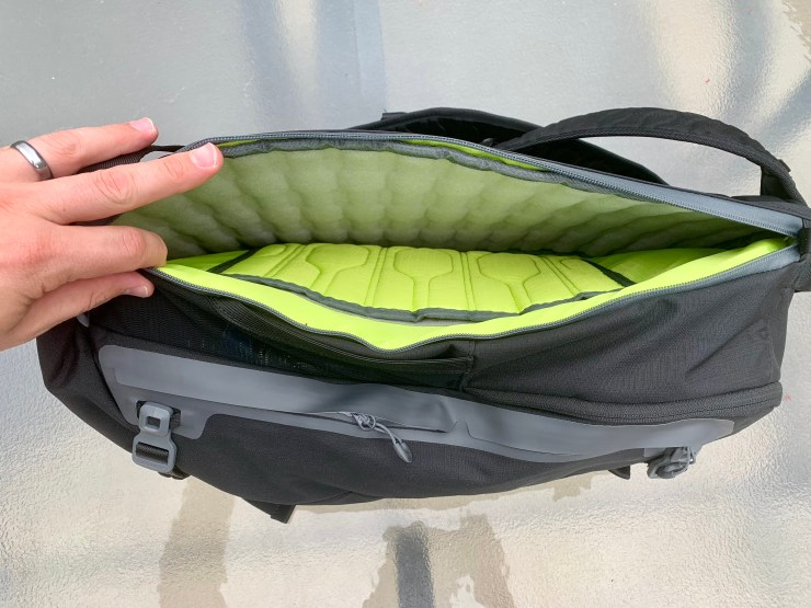 A padded pocket protects up to a 15-inch laptop.