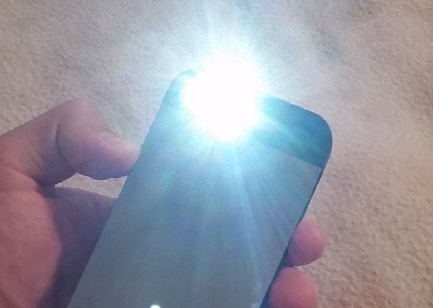 Why Is My iPhone Flashlight Turning Itself On & How to Quickly Turn