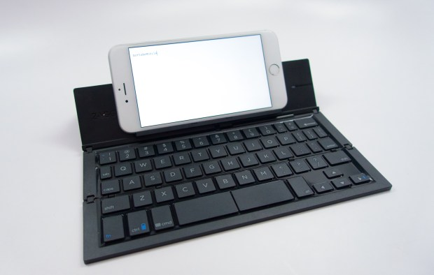 Stick your iPhone 6 Plus, iPhone 6 or other Android device on a small fold out ledge and get to typing.