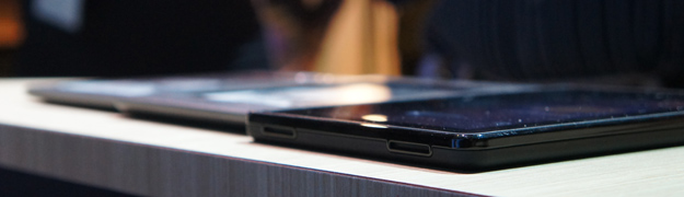 Amazon Kindle Fire next to a Kindle Touch and Kindle