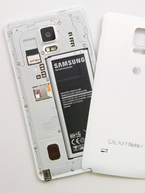 The Galaxy Note 4's rear cover hides a giant battery, microSD card slot and SIM card slot.