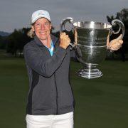 Image of Karen Garcia hoisting the trophy