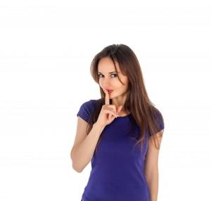 "image of girl gesturing ""no talking"""