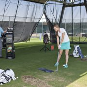 Image of woman at golf practice