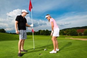 Image of man and woman golfing