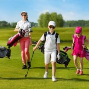 Images of kids who carry golf clubs