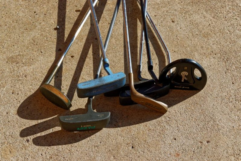 Image of beat-up golf clubs