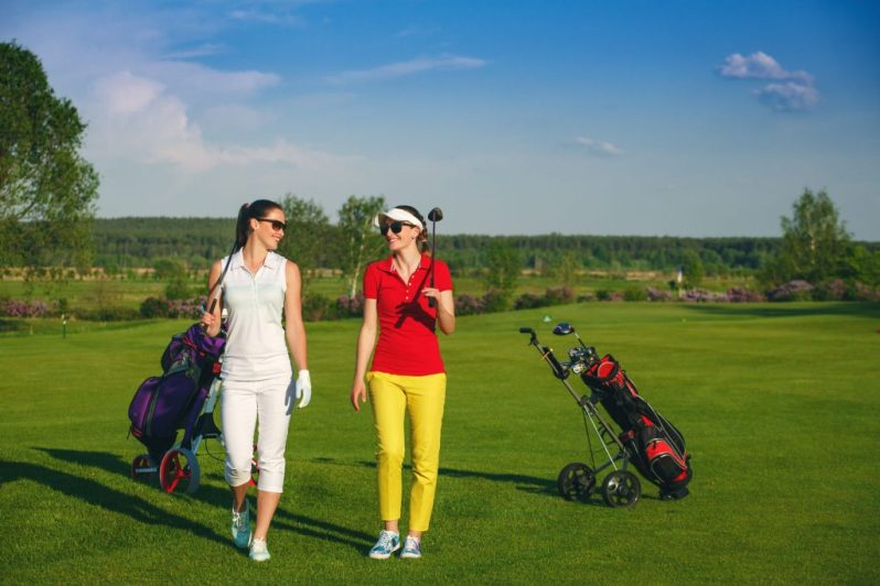 Image of two friends playing golf