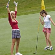 Image of women golfers celebrating hole-in-one