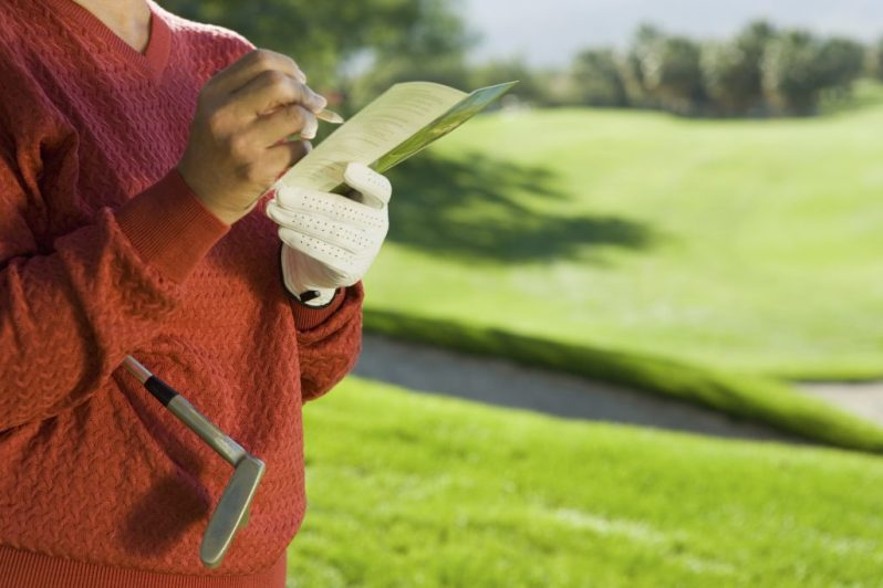 Image of woman signing scorecard
