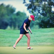 Image of female golfer celebrating