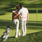 Image of couple on a golf date
