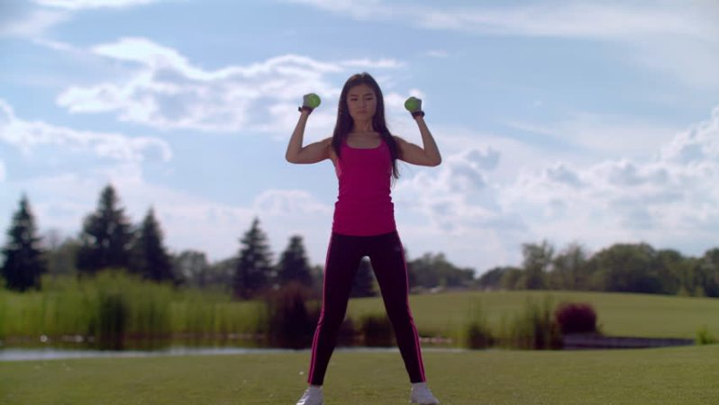 image of woman exercising on golf course