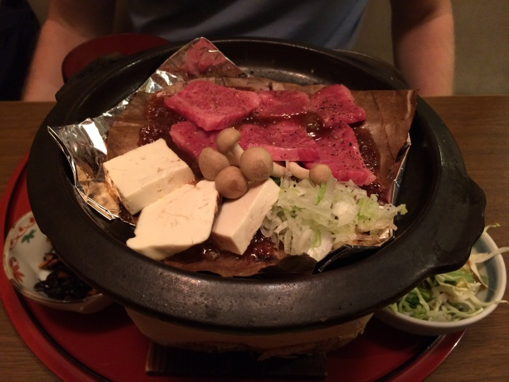 Kevin cooks the Hida Beef at the table.
