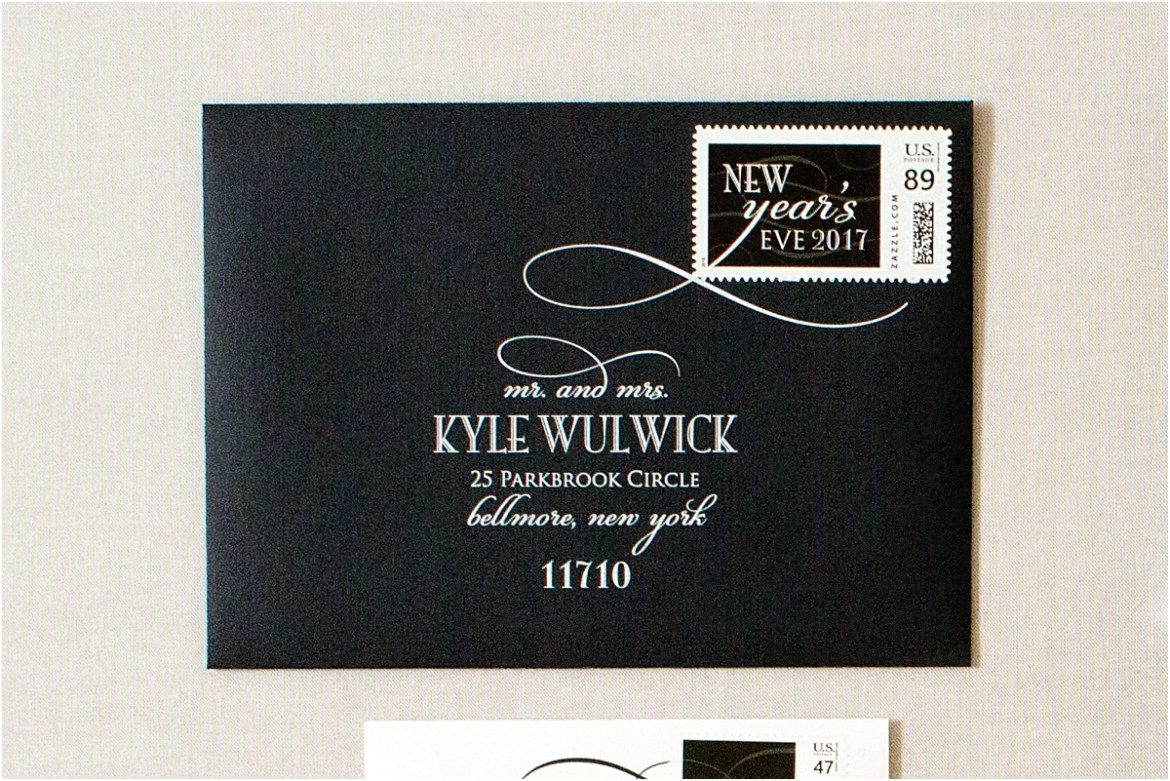 black envelope white address