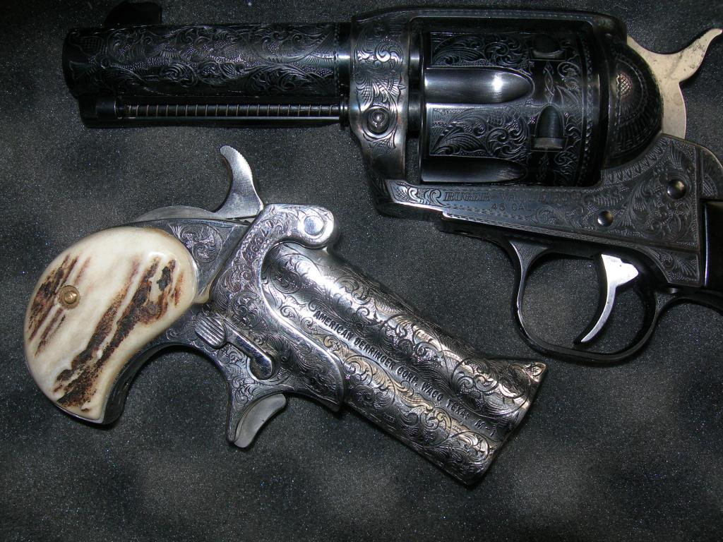 Nice pair of engraved cowboy guns