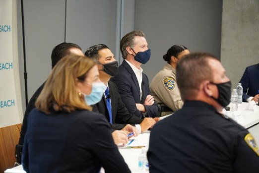 Governor sits at table with law enforcement leaders
