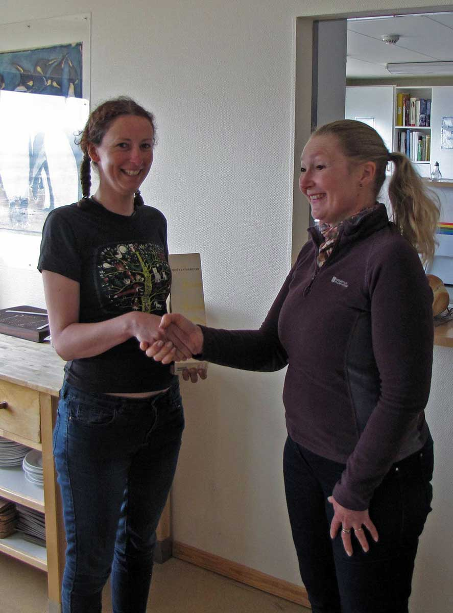 Sarah Lurcock presents Stephanie Winnard (left) with a bottle of champagne for finding the first breeding pipits in the southern area.