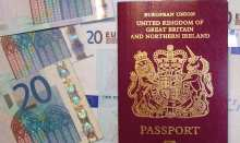 British passport with 20 Euro notes