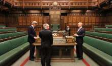 Four men in centre of house of commons