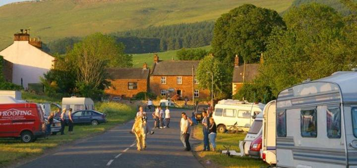 Travellers caravans by side of road in English village