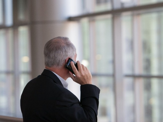 business man on-hold on mobile