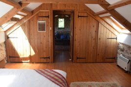 The master bedroom at Delvid Stables holiday cottage, Llangennith, Gower