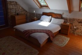 The master bedroom at Delvid Stables holiday home, Llangennith, Gower