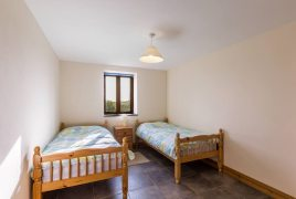 The twin bedroom at The Tractor House self-catering cottage, Llethryd, Gower