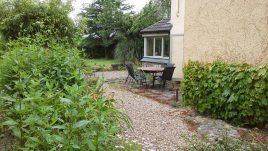 The garden dining area at Brook Cottage self-catering accommodation, Reynoldston, Gower