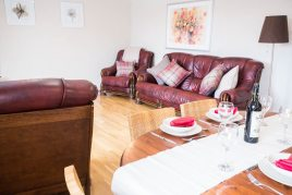 The dining and living areas at Honeywell Cottage self-catering cottage, Oxwich, Gower