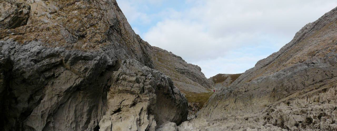 Paviland Cave (Goat's Hole) to the left of the valley