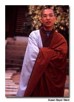 Monks instruct visitors on temple etiquette.