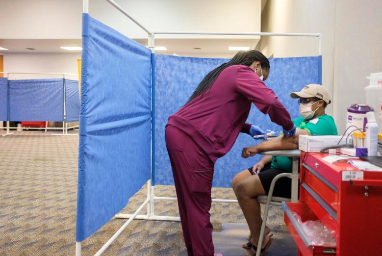 Nikeira Hall gives a blood sample as a part of the Augusta University coronavirus antibody study in Dougherty County at the Albany Civic Center recently.