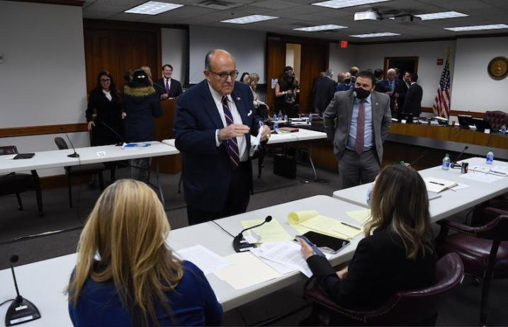 Rudy Guiliani talks with Georgia State Sens. Jen Jordan (D-Atlanta) and Elena Parent (D-Atlanta) during a break in a Georgia State Senate hearing Thursday, Dec. 3, 2020.