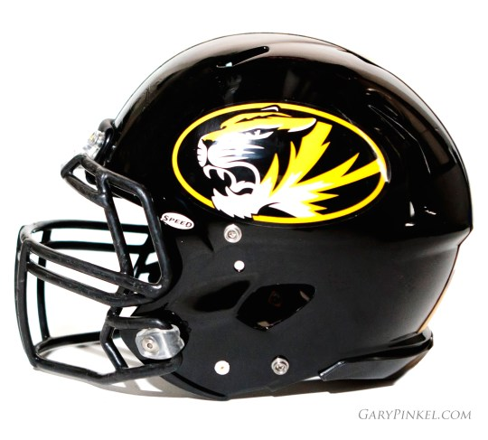 The traditional Mizzou Tiger football helmet has the tiger head logo on each side.