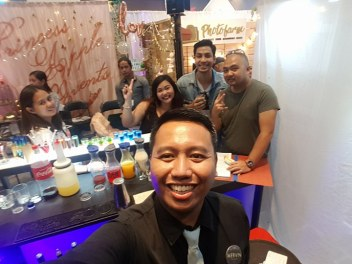 GQ's Head Bartender Mervin with clients