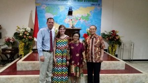 Emma standing with me and Pastor and Mrs. Marcos for photos after the evening service.