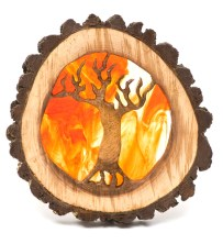Tree of Life; tree ring with bark, with core carved into outline of tree with roots and branches, and a background painted in fiery fall colors.