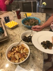 Bread and Wine dinner: roasted brussels sprouts, roasted rosemary potatoes, kale and arugula salad from Run Fast Eat Slow